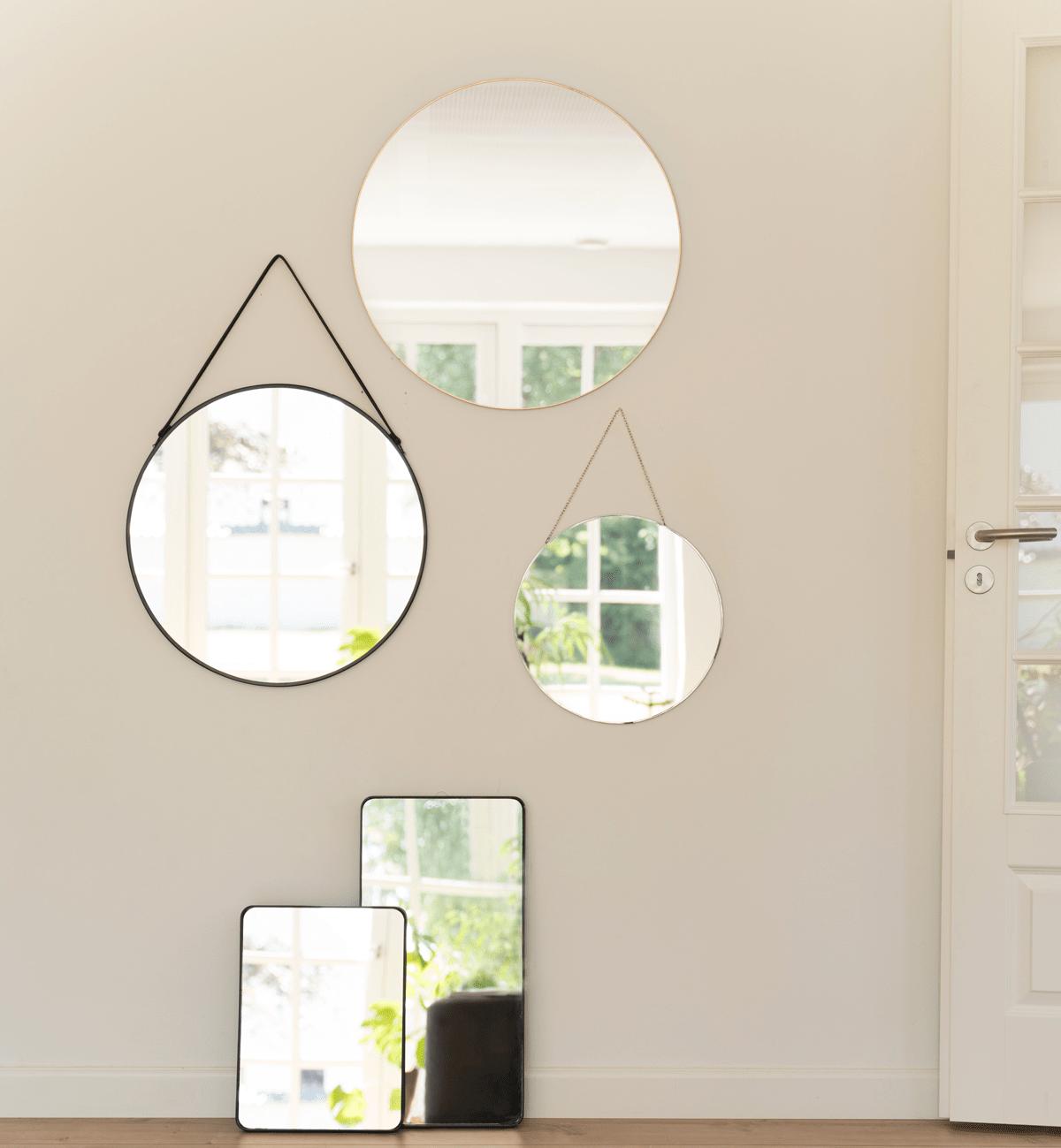 Få rummet til at se større ud med spejle